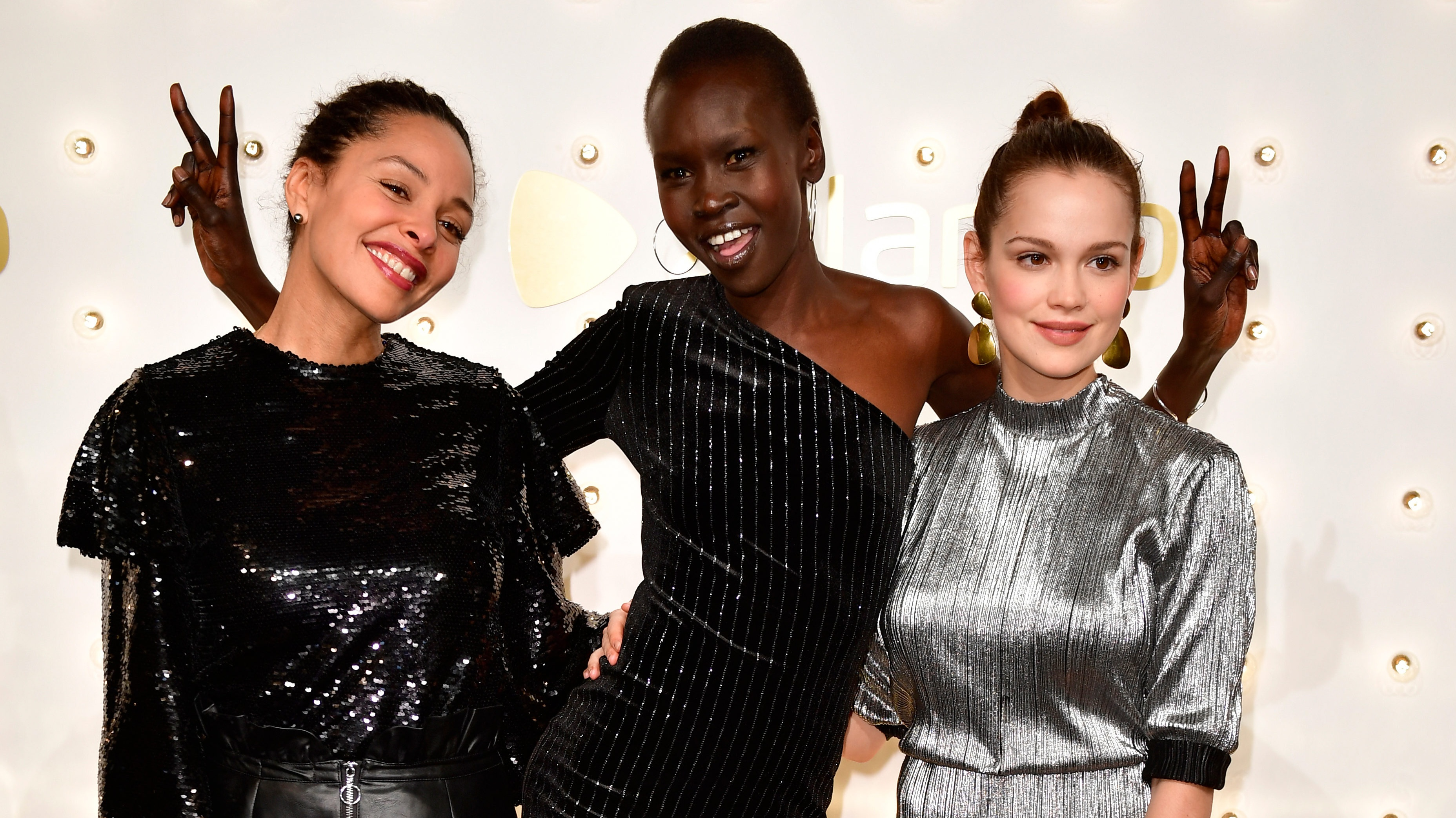 BERLIN, GERMANY - DECEMBER 13: (L-R) Joy Denalane, Alek Wek and Emilia Schuele attend the Zalando xmas bash hosted by Alek Wek at Haus Ungarn on December 13, 2017 in Berlin, Germany. (Photo by Alexander Koerner/Getty Images for Zalando)