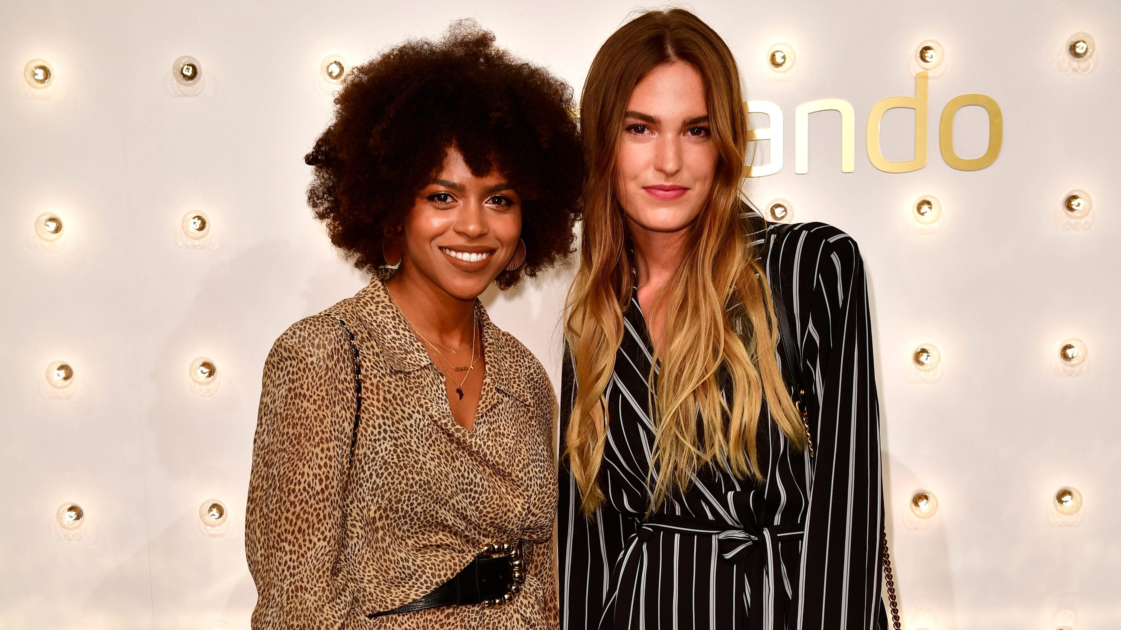 BERLIN, GERMANY - DECEMBER 13: Aminata Belli and Hannah Liza attend the Zalando xmas bash hosted by Alek Wek at Haus Ungarn on December 13, 2017 in Berlin, Germany. (Photo by Alexander Koerner/Getty Images for Zalando)